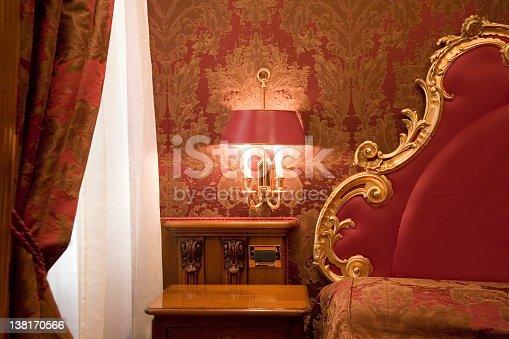 Classic italian hotel room with barocco ornaments.