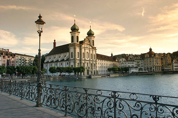 baroque cathedral on luzern waterfront - lucerne stock pictures, royalty-free photos & images
