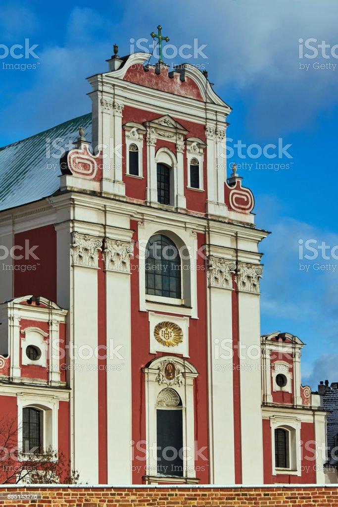 Baroque Catholic Church behind medieval defensive wall stock photo