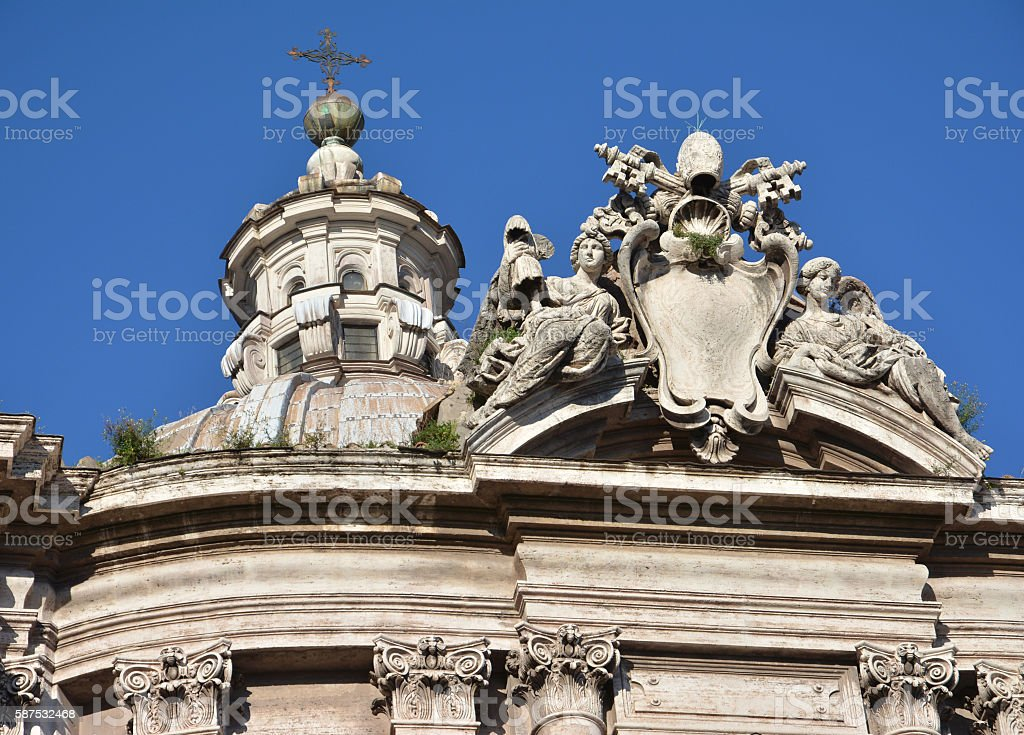 Baroque dome lantern and Pope coat of arms stock photo