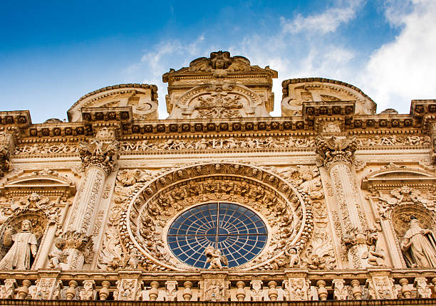 baroque facade of basilica di santa croce in lecce, italy - rose window stock pictures, royalty-free photos & images