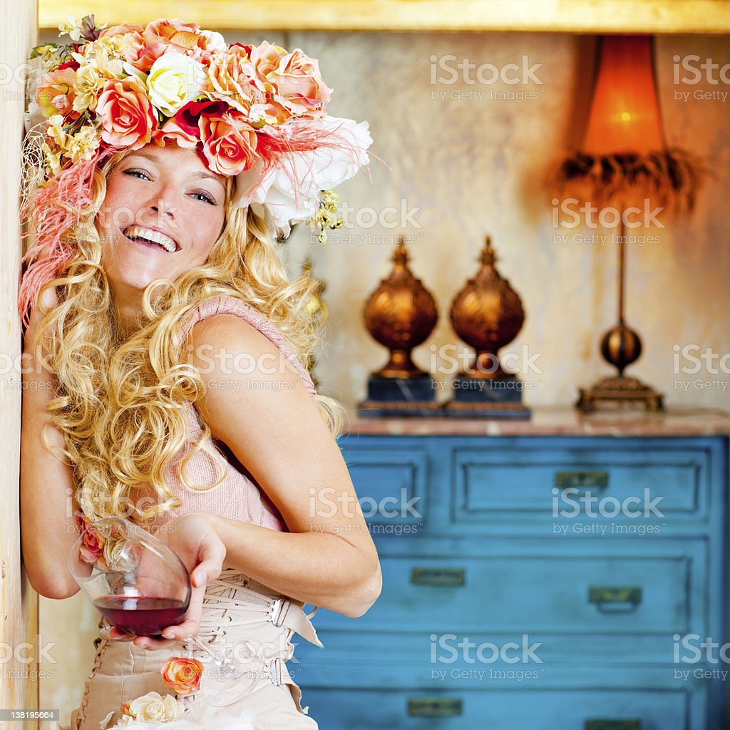 baroque fashion blond womand drinking red wine stock photo