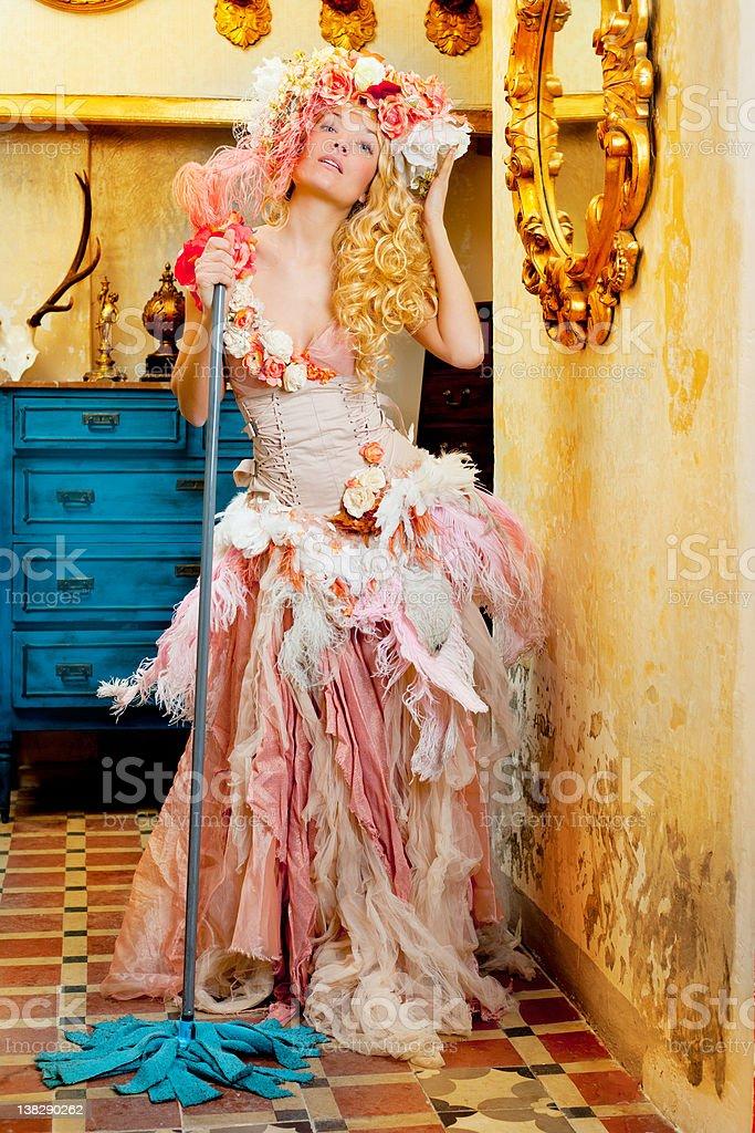 baroque fashion blonde housewife woman mop chores stock photo