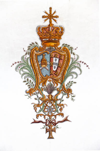 Baroque fresco of the Portuguese Royal Coat of Arms with Vatican. stock photo