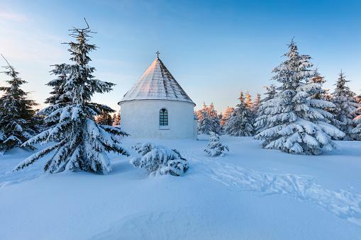 Baroque Kunstatska Kaple (chapel), Jiraskova cesta, Orlicke hory, Eagle mountains, Rychnov nad Kneznou region near Hradec Kralove, Eastern Bohemia, Czech Republic Beautiful Sunrise in Winter time.