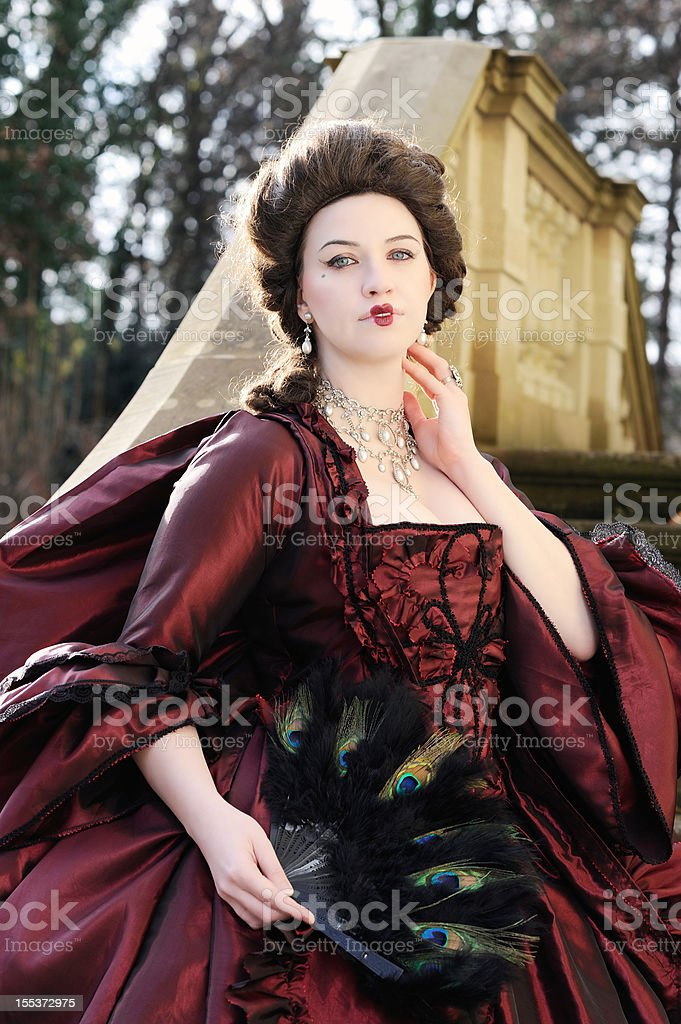 Baroque Lady with beautiful Red Old Dress Outdoor royalty-free stock photo