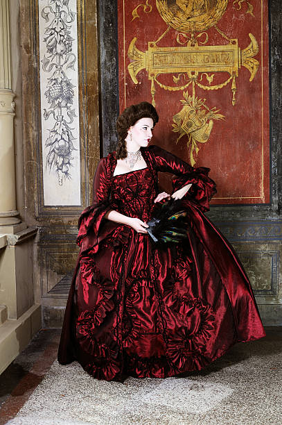 Baroque Lady with Red Dress before Old Wall stock photo