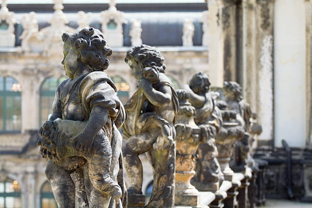 "Baroques sculptures on roof gallery of Zwinger ""Baroques sculptures on roof gallery of Zwinger in Dresden, famous sight seeing landmark in Saxony."" zwanger stock pictures, royalty-free photos & images"