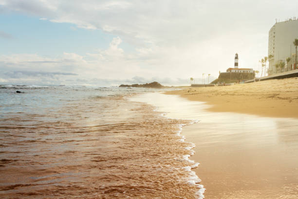 Barra beach during sunset with lighthouse background stock photo
