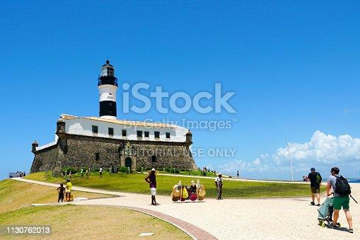 Tourist visiting Farol da Barra (Barra Lighthouse) in Salvador, Bahia, Brazil.  The historic architecture of Salvador in Bahia, the Farol da Barra Lighthouse at Bahia de Todos os Santos Bay. 02/05/2019