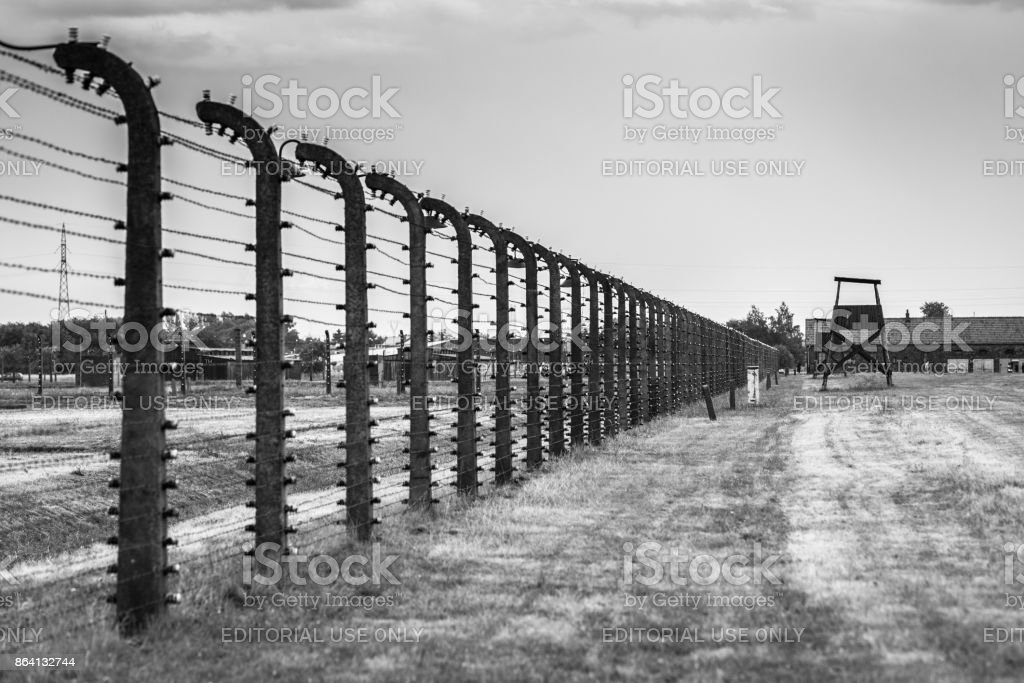 AUSCHWITZ, POLAND - July 11, 2017.Barracks and barbed wire in a concentration camp in Auschwitz (Poland).Museum Auschwitz - Birkenau.Barbed wire around a concentration camp. royalty-free stock photo