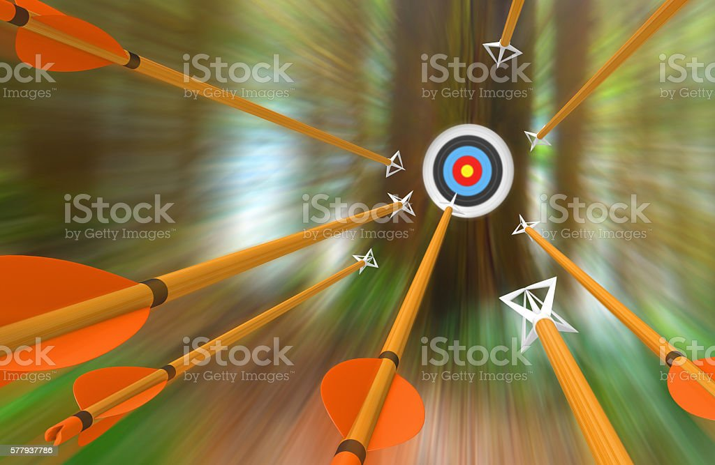Barrage of arrows flying to archery target in blurred motion stock photo