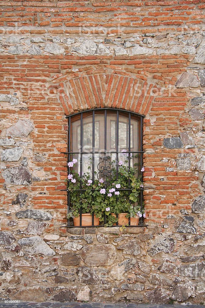 Barred window at brickwall royalty-free stock photo