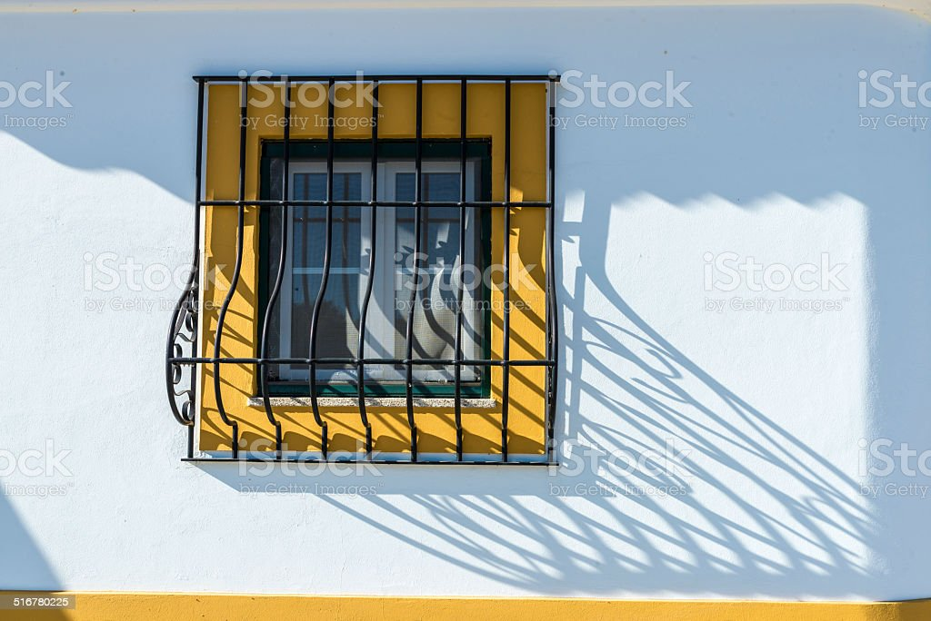 barred window in Evora, Portugal stock photo