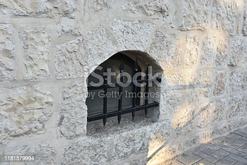 Barred Window in Stone Wall at The Alamo Window with bars antique stone wall.