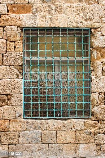 905087856istockphoto Barred window 1144181032
