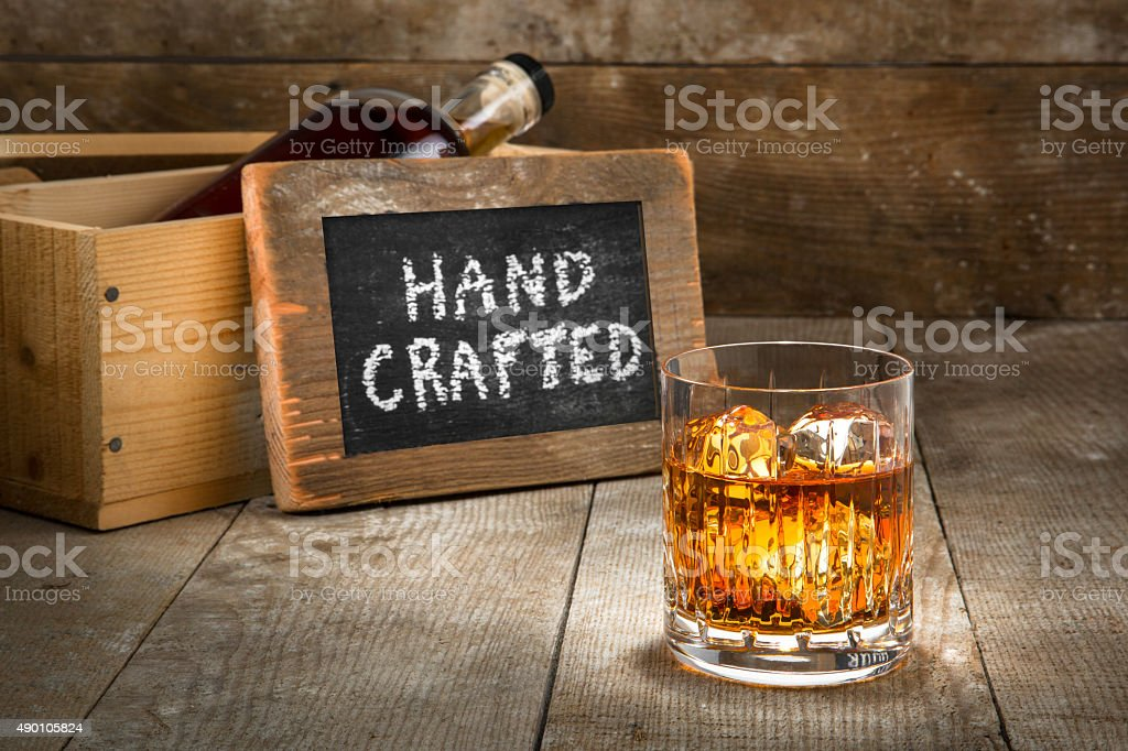 Barrel aged craft liquor bourbon whisky scotch brandy wood bar stock photo