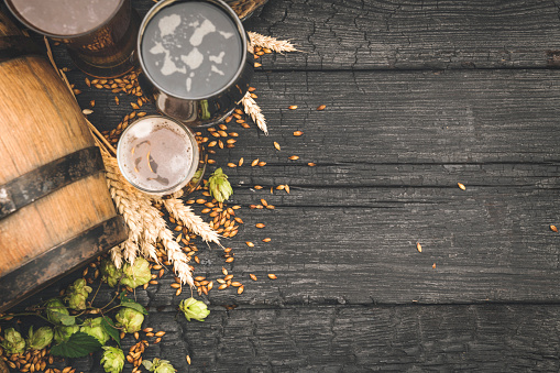 istock Barrel and Glass beer with Brewing ingredients. 1173572056