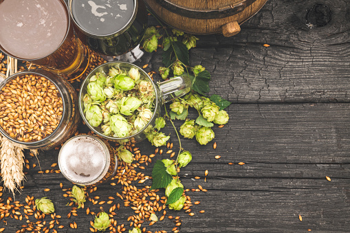 istock Barrel and Glass beer with Brewing ingredients. 1173572795