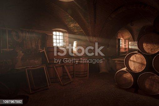 istock Barrel making workshop in old basement. Wine cellar. 1097967552