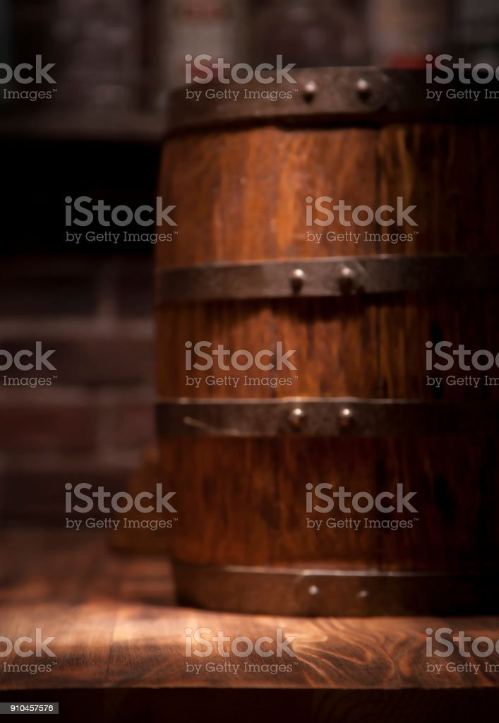 Barrel of whiskey on rustic table.blur bar background stock photo
