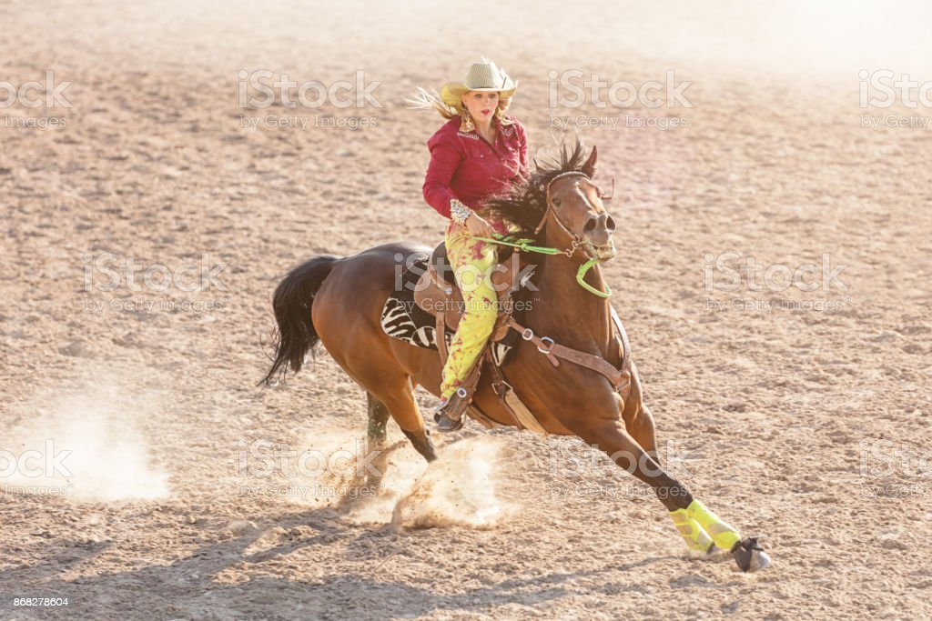Barrel Racing Competition Cowgirl Speeding stock photo