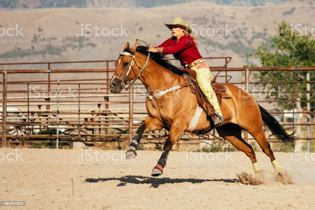 Barrel Racing Cowgirls in a Rodeo stock photo