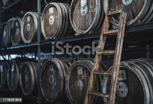 Barrels in distillery with old alcohol.