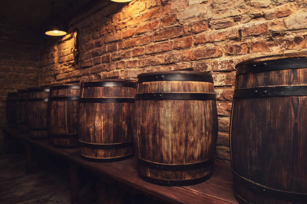 barrels in the wine cellar - barrel stock pictures, royalty-free photos & images