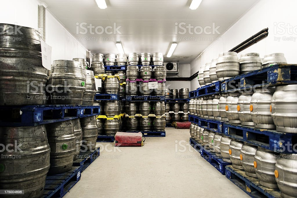 Barrels of beer in storage stock photo