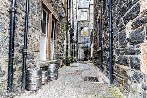 Barrels of beer standing in an alley