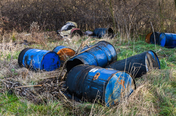 Barrels of toxic waste in nature Barrels of toxic waste in nature, pollution of the environment. toxic waste stock pictures, royalty-free photos & images