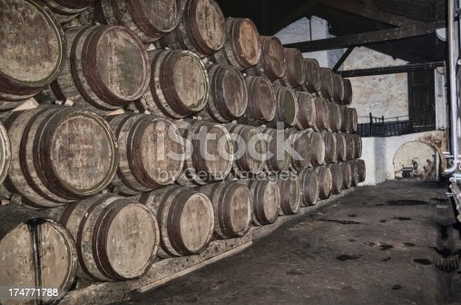 Barrels of port wine stored in a warehouse.