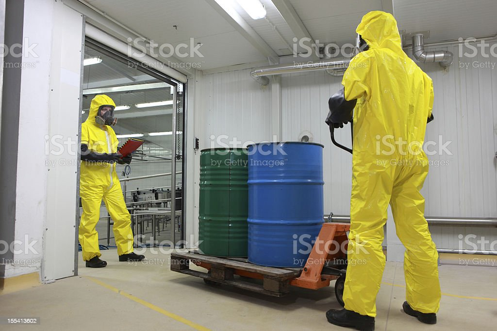 barrels with chemicals delivery in factory stock photo