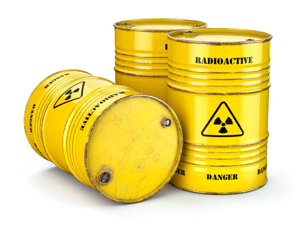 Barrels with radioactive waste isolated on white, Manufacturing of nuclear power and utilization of radioctive materials. stock photo
