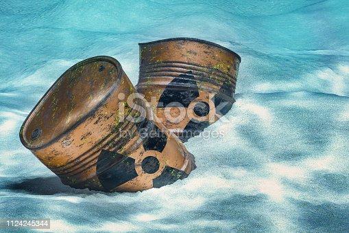 istock Barrels with radioactive waste on ocean bottom underwater. 3D rendering 1124245344