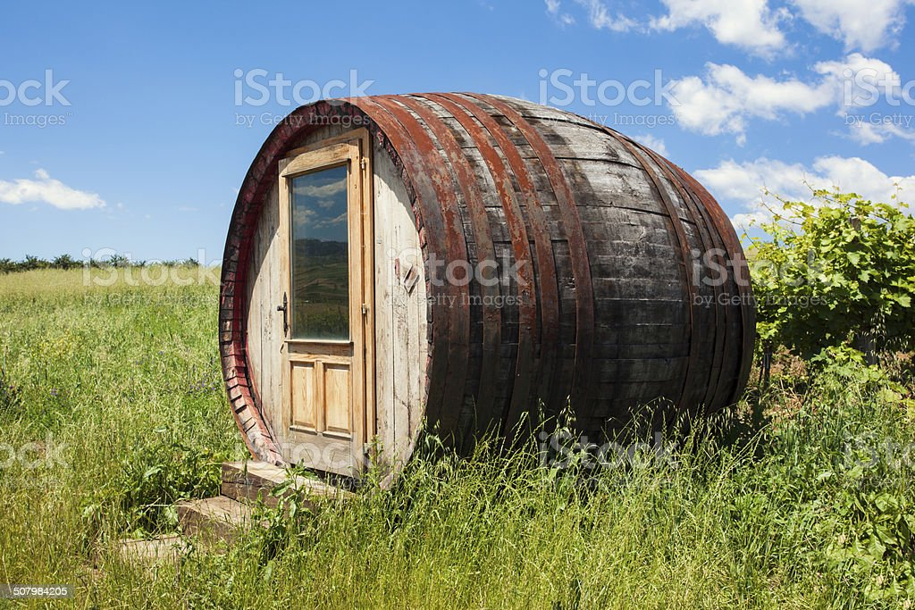 Barrel-shaped room by the vineyards stock photo
