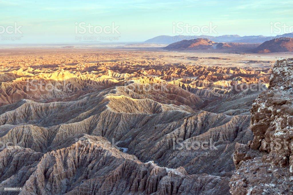 barren desert landscape during dusk stock photo
