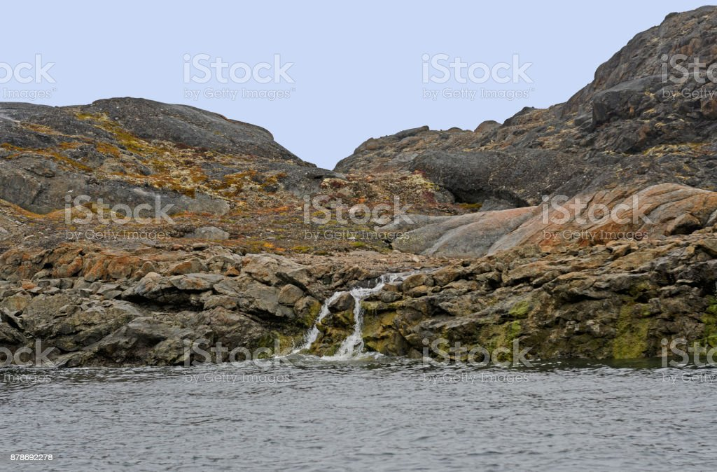 Barren Rock and a Stream in the High Arctic stock photo