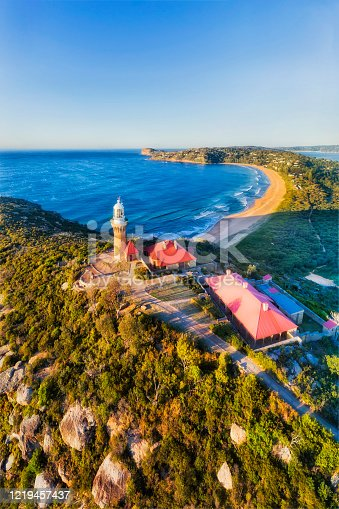 Barrenjoye head and lighthouse on its top overlooking Palm beach at Sydney Northern Beaches. Aerial vertical panorama.