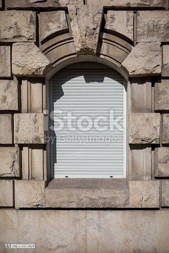 Barricaded window in an old building in Berlin