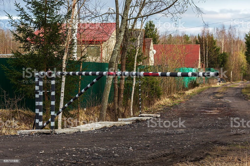 Barrier on a gravel street. royalty-free stock photo