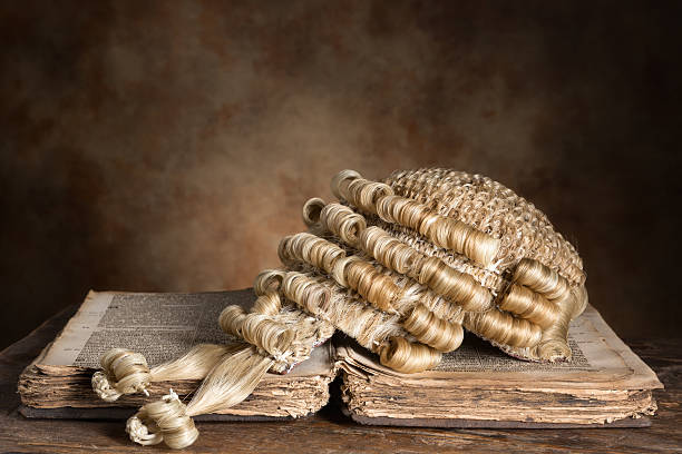 Barrister's wig on old book stock photo