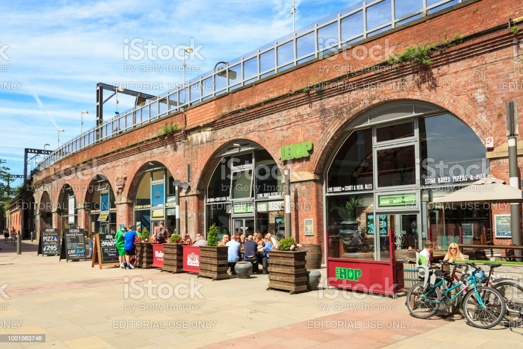 Bars and restaurants in The Dark Arches beneath the railways station in Leeds stock photo