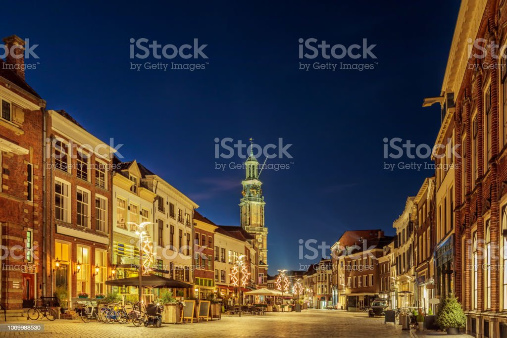 Bars and restaurants with christmas lights on the Houtmarkt square in...
