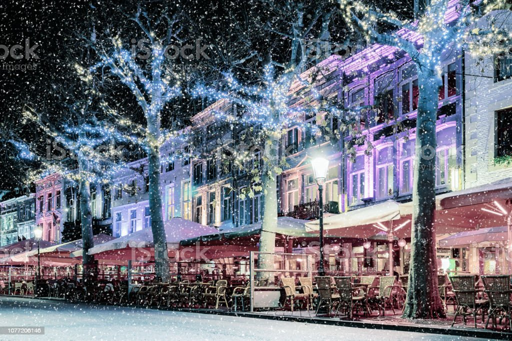 Bars and restaurants with christmas lights on the famous Vrijthof...