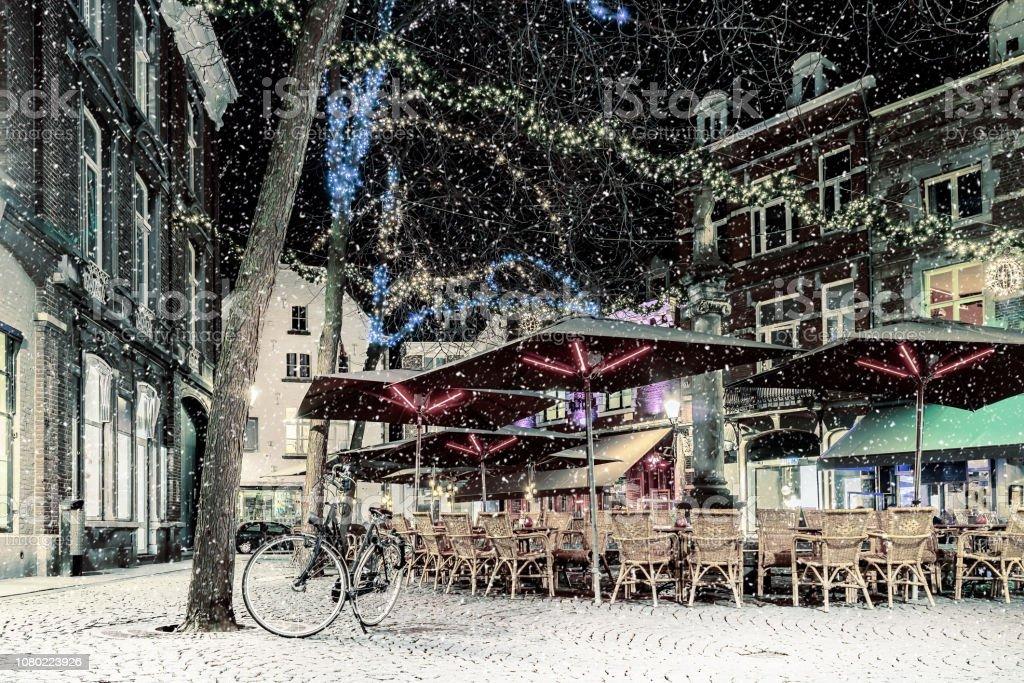 Bars and restaurants with christmas lights on the Sint Amorsplein...