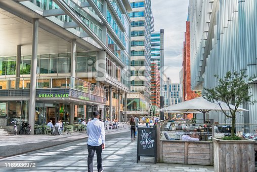 Amsterdam, Claude Debussylaan, the Netherlands, 08/23/2019, Bars, lunch cafes, restourants,Street in the Amsterdam Zuidas (South axis) business district, modern office buildings, shopping