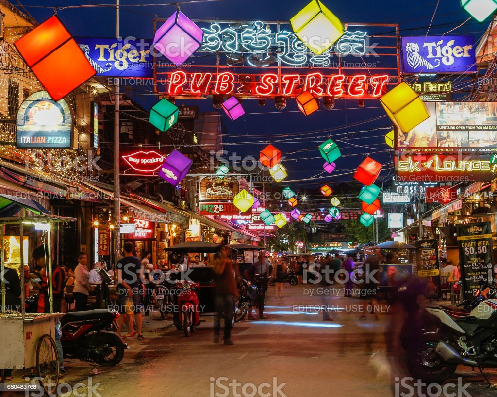 Bars, restaurants and lights along Pub Street in Siem Reap Cambodia at night stock photo