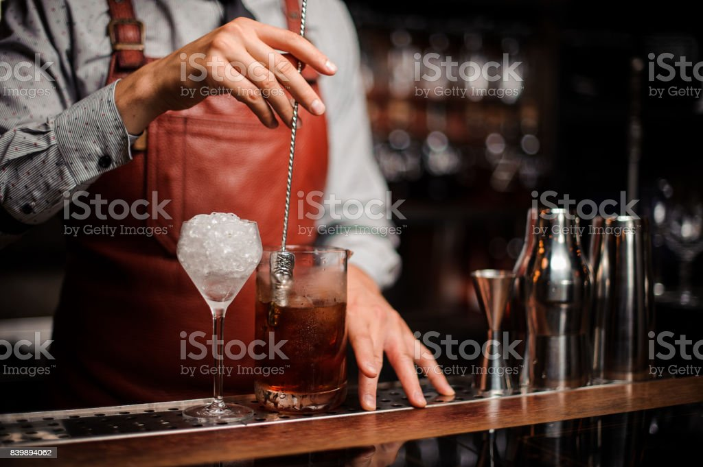 Bar-shaped spoon in the form of a finger stock photo